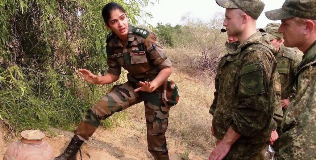 Indian Army woman officer giving demonstration about handling ammunition to foreign troops.