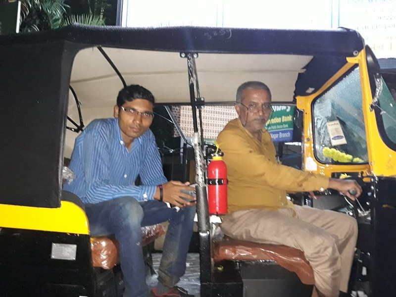 Rahul Shitole sitting in autorickshaw of his father Rajendra Shitole, who inspired him to launch the autorickshaw app.