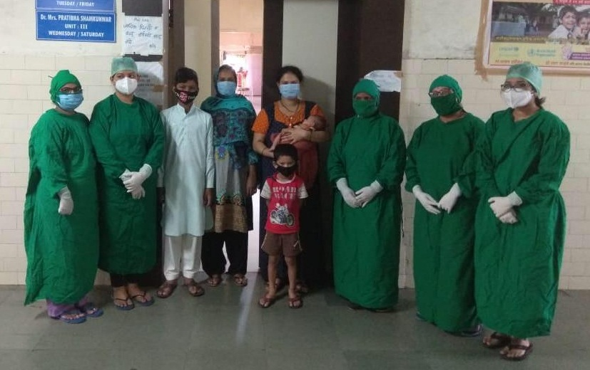 YCM hospital doctors and woman with her kids