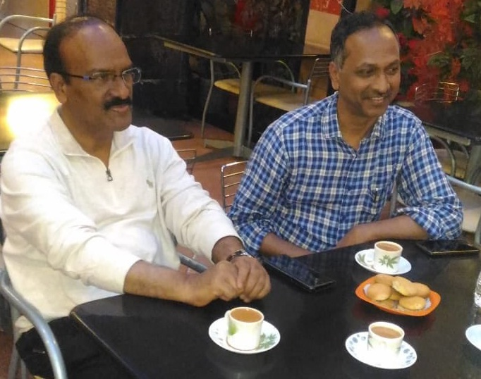 Dr Venkatesham and his friend Dr Janardhan Reddy (then Hyderabad Municipal Commissioner) discussing best practices for Public Service over chai-biscuit at a hotel in Hyderabad in August 2018.